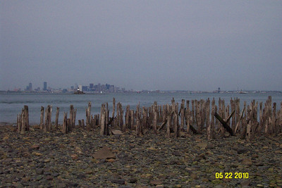 An old pier on Lovells Island with Boston in the background.