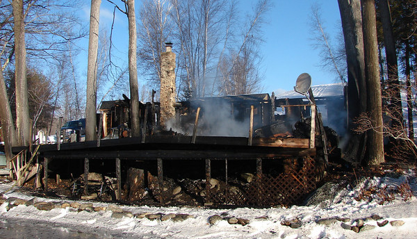 """New Hampshire State Fire Marshal J. William Degnan, Henniker Police Chief Ryan Murdough, and Henniker Fire Chief Keith Gilbert, announced that the fire reported at 6 Hemlock Corner Loop at 5:27 a.m. on January 4th has been determined by investigators to be """"incendiary""""."""