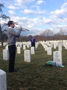 Joe Conti plays Taps to honor fallen LHS Alumnus Peter Sohm at Arlington National Cemetery. Photo Brook R.