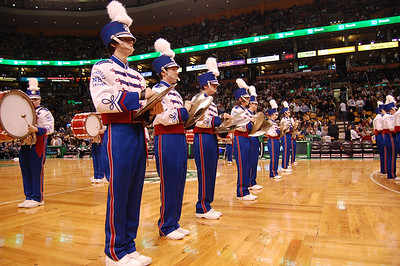 Tyler Guay of Londonderry High School Marching Lancer Drum Line (left) leads his row of cymbalists during the band's halftime show at Tuesday's Boston Celtics game against the New York Knicks. Photo by Alec O'Meara