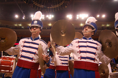 Londonderry High School Marching Lancer Drum Line's Suzanne Darcy (left) and Mike Holahan pose at the end of the band's performance on the parquet floor of TD Bank Garden at halftime of Tuesday's Boston Celtics game against the New York Knicks.