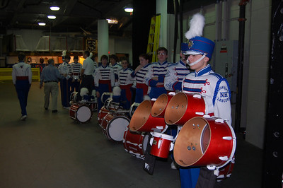 Londonderry High School Marching Lancer Drum Line captain Aaron Beyea (far right) waits backstage to lead his fellow mand members onto the parquet floor of TD Bank Garden for a halftime performance during Tuesday's Boston Celtics game against the New York Knicks.