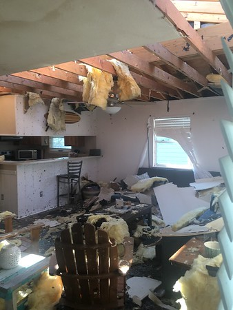The contractor provided this photo.   I think we are going to need a new living room.
