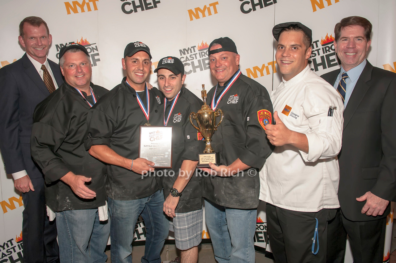 Suffolk County Chief of Police Stuart Cameron with the winning Suffolk County team and Chef Angelo Rodrigues Chief of Patrol Robert Brown.