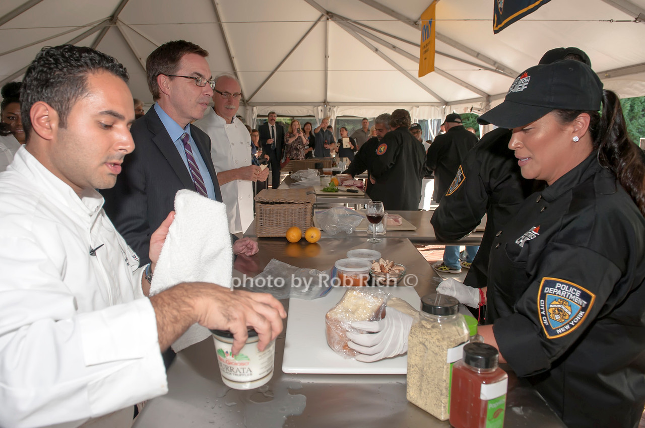 Chef Anton Vazanellis with team NYPD, and judges Dr. Jerry Balentine and Bill Holden.