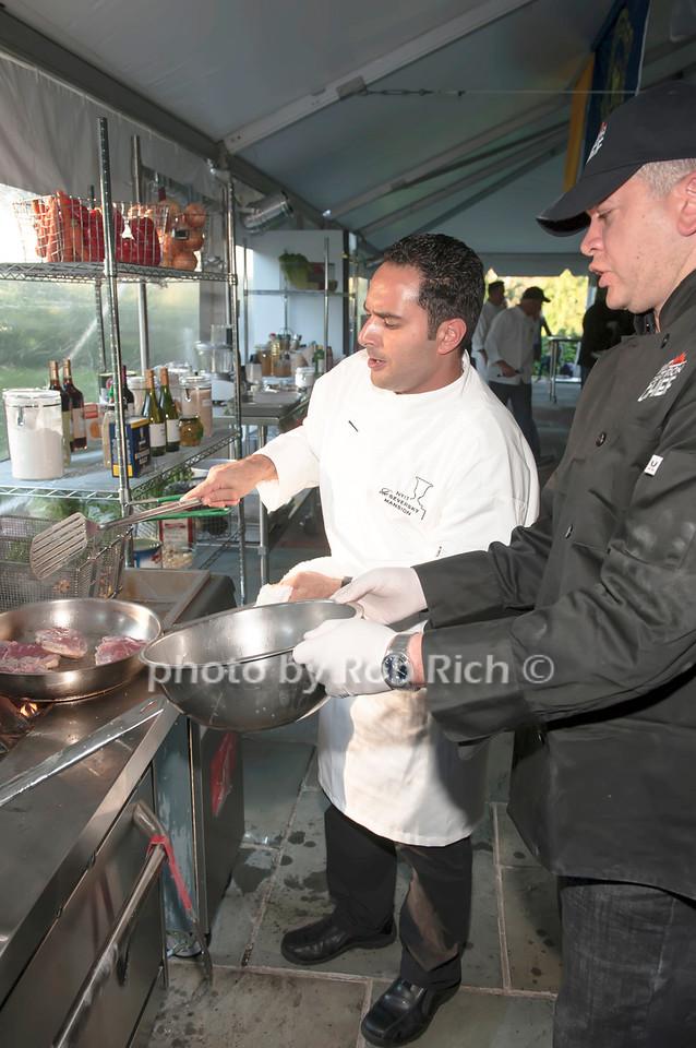 Chef Anton Vazanellis with NYPD team member Julio Cabreja,