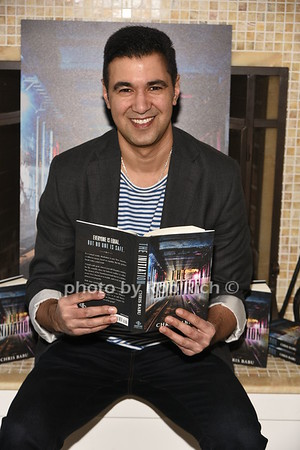 "Chris Babu signing his new book ""The Initiation"""