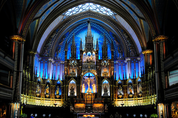 One of the most beautiful buildings in Montreal, inside and out, is certainly the Basilique Notre-Dame.  Unfortunately it was pouring rain when we arrived and I had not brought my tripod either.  Therefore interior shots are somewhat blurry and exterior shots there are none.