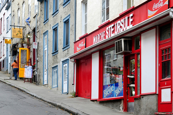 Streets are hilly and colorful in Old Quebec, since almost all the window frames and doors are brightly and lovingly painted, whether in red...