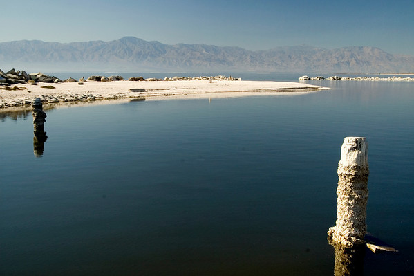 """From what I understand, this geographical area was called the """"Salton Sink"""" due to the salt mining in the region many decades before it flooded and became the Salton Sea.  Salinity is one of the sea's biggest problems today and salt is certainly abundant if I correctly interpret the whiteish crust on this pole."""