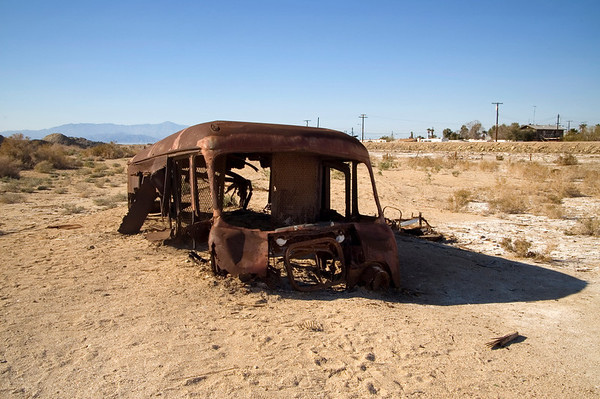 Decaying bus sunken into mud and sand at the same location - who can tell me what make and model this is?