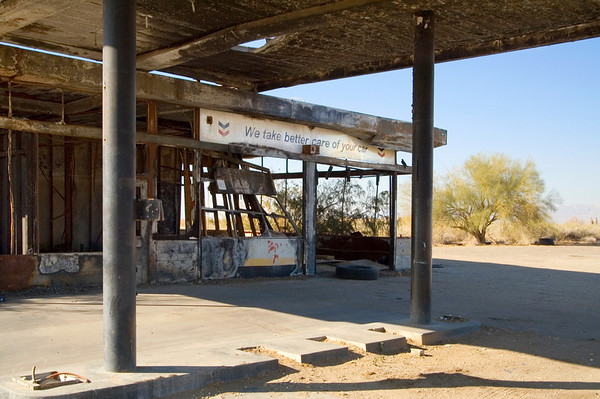 "Burned out gas station in Niland.  I particularly liked the sign reading ""we take better care of your car""."
