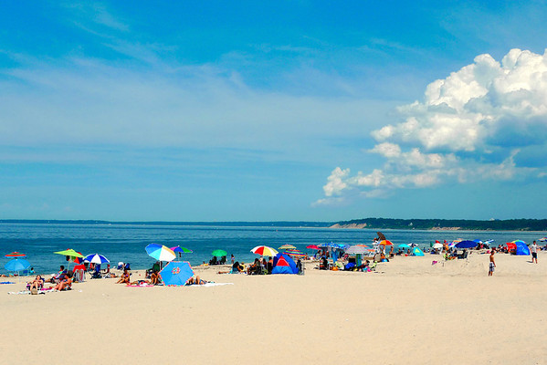 Sun bathers at Sunken Meadow State Park on a bright summer's day