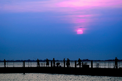 Late afternoon anglers on the fishing pier at Robert Moses State Park