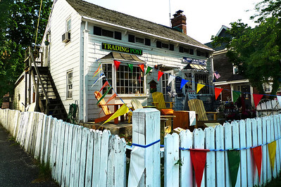 The Northport Trading Post.  New York made goods like Adirondack Chairs, local preserves, chainsaw carvings, upstate cheeses, or just your morning paper along with a fresh cup of coffee.