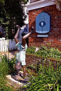 Bronze sculpture in yard of Main Street dentist's office.