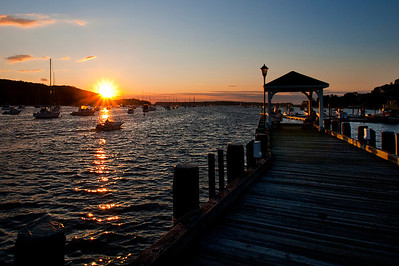 The sun is setting over Northport's harbor