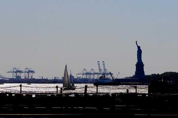 Statue of Liberty presiding over a silver NYC Harbor