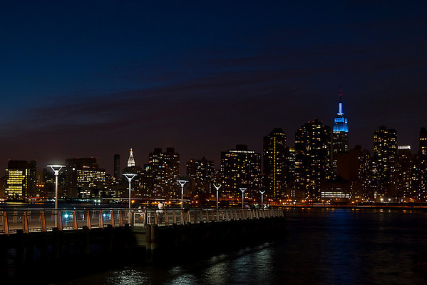 Gantry State Plaza in Queens at nightfall, with Empire State Building in the background