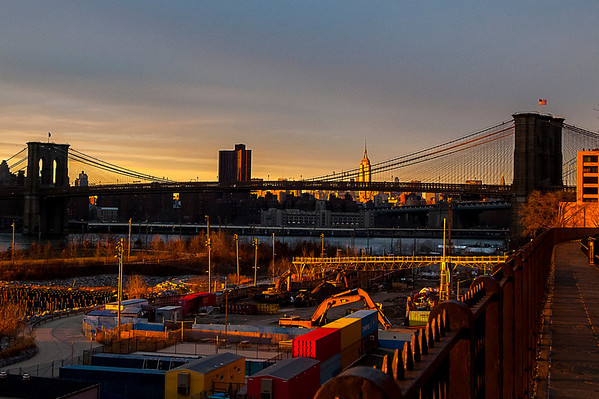 Sunset shot of Brooklyn Bridge and Empire State Building as seen from the Brooklyn Heights Promenade