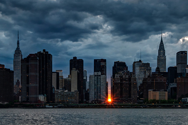 """Manhattanhenge"", when the setting sun perfectly aligns with the east-to-west cross streets on Manhattan's grid, as seen from Hunter's Point/Queens on May 30, 2014."