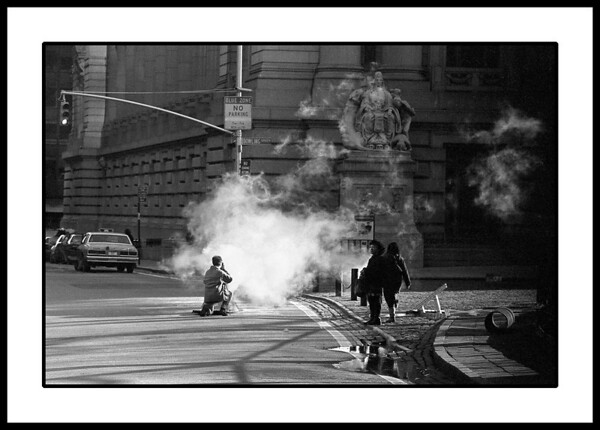 Photographing a photographer photographing steam in downtown Manhattan