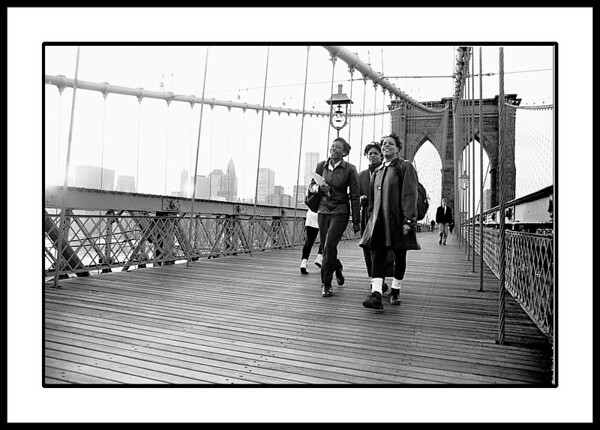 Girls having fun while strolling across the Brooklyn Bridge
