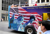 NYC tour bus with Statue of Liberty painted on it's side.
