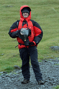 This is me in my complete wet weather kit: my very warm down filled Rab jacket, wearing waterproof pants, gloves and with a spray cover protecting my camera. This was all very important on the cold wet, windy morning that we visited Látrabjarg.