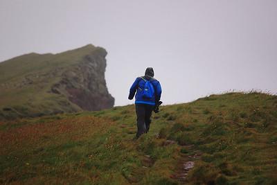 Dennis walks against the wind