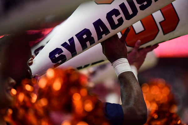 SU Cheerleaders help make the dome into the loud house.