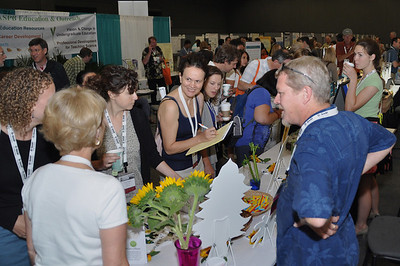 Highlight the success of your exhibitors with social media photography.