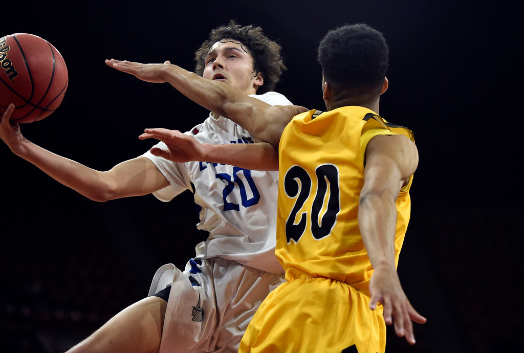 . DENVER, CO - MARCH 8, 2019: Longmont High School\'s Jaydon Elkins goes for a layup over Darnell Kindred during a CHSAA 4A Final Four playoff game against Pueblo East on Friday at the Denver Coliseum. Longmont won the game. More photos: BoCoPreps.com (Photo by Jeremy Papasso/Staff Photographer)