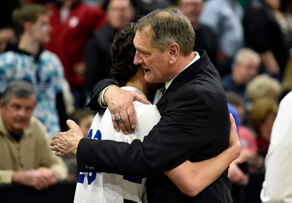 . DENVER, CO - MARCH 8, 2019: Longmont High School Head Coach Jeff Kloster hugs Jaydon Elkins after winning  a CHSAA 4A Final Four playoff game against Pueblo East on Friday at the Denver Coliseum. Longmont won the game. More photos: BoCoPreps.com (Photo by Jeremy Papasso/Staff Photographer)
