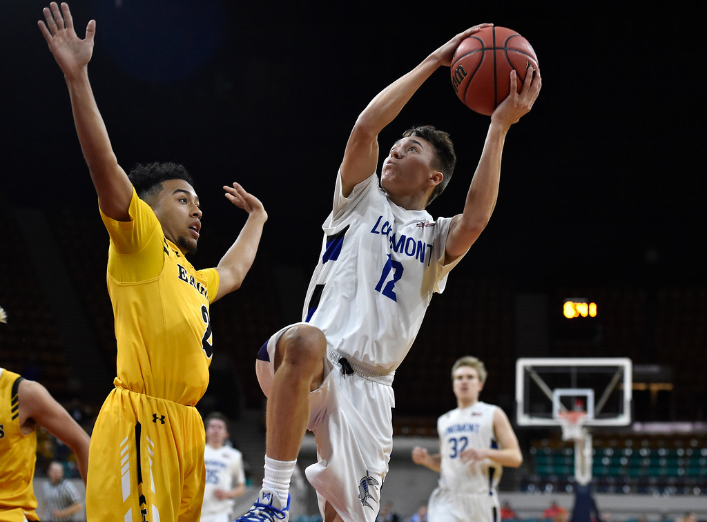 . DENVER, CO - MARCH 8, 2019: Longmont High School\'s Brady Renck takes a shot over Marvin London during a CHSAA 4A Final Four playoff game against Pueblo East on Friday at the Denver Coliseum. Longmont won the game. More photos: BoCoPreps.com (Photo by Jeremy Papasso/Staff Photographer)