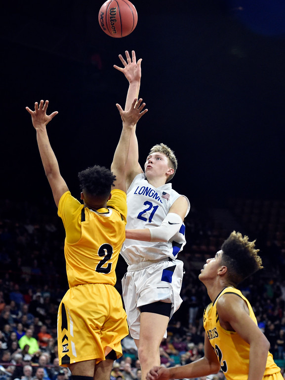 . DENVER, CO - MARCH 8, 2019: Longmont High School\'s Dallas Dye takes a shot over Marvin London during a CHSAA 4A Final Four playoff game against Pueblo East on Friday at the Denver Coliseum. Longmont won the game. More photos: BoCoPreps.com (Photo by Jeremy Papasso/Staff Photographer)