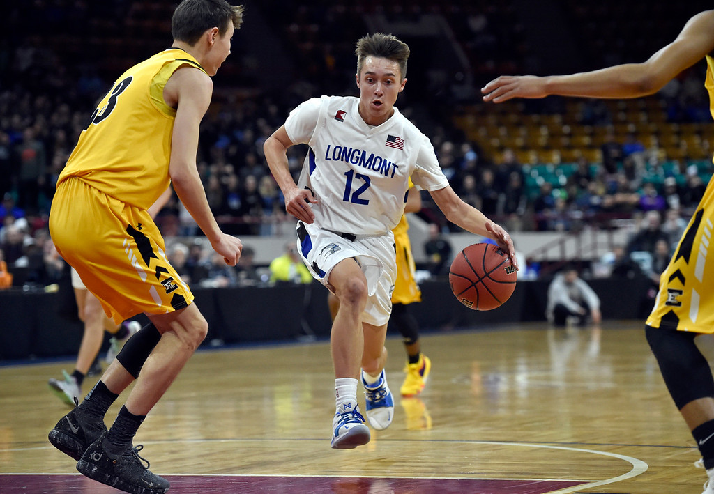 . DENVER, CO - MARCH 8, 2019: Longmont High School\'s Brady Renck drives to the hoop past Kyle Miller during a CHSAA 4A Final Four playoff game against Pueblo East on Friday at the Denver Coliseum. Longmont won the game. More photos: BoCoPreps.com (Photo by Jeremy Papasso/Staff Photographer)