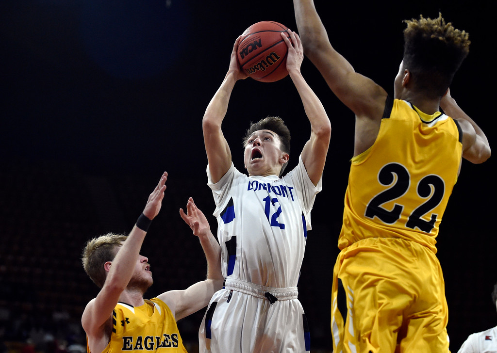 . DENVER, CO - MARCH 8, 2019: Longmont High School\'s Brady Renck takes a shot over Jaxson Herring during a CHSAA 4A Final Four playoff game against Pueblo East on Friday at the Denver Coliseum. Longmont won the game. More photos: BoCoPreps.com (Photo by Jeremy Papasso/Staff Photographer)