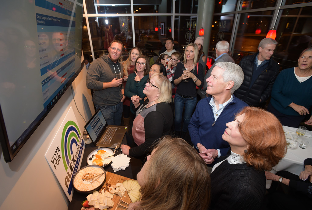 . A crowd watches the early Longmont election results appear at Bin 46 Wine Bar & Restaurant Tuesday night. Lewis Geyer/Staff Photographer Nov. 07, 2017