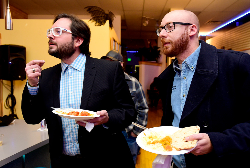 . Aren Rodriguez, candidate for City Council at-large, left, watches election results with Rep. Jonathan Singer, right, at KCP Art Bar in Longmont, Colorado on Nov. 7, 2017. (Photo by Matthew Jonas/Times-Call)