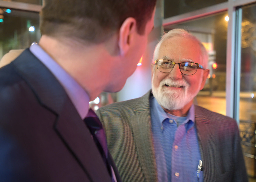 . Longmont council ward 2 candidate Jeff Moore talks with mayoral candidate Brian Bagley while waiting for election results at Bin 46 Wine Bar & Restaurant Tuesday night. Lewis Geyer/Staff Photographer Nov. 07, 2017