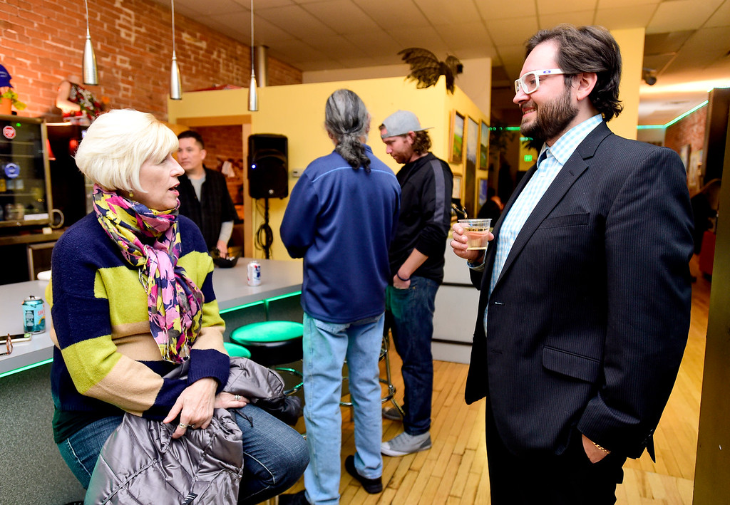 . Aren Rodriguez, candidate for City Council at-large, right, talks with Marisa Dirks, left, while watching election results at KCP Art Bar in Longmont, Colorado on Nov. 7, 2017. (Photo by Matthew Jonas/Times-Call)