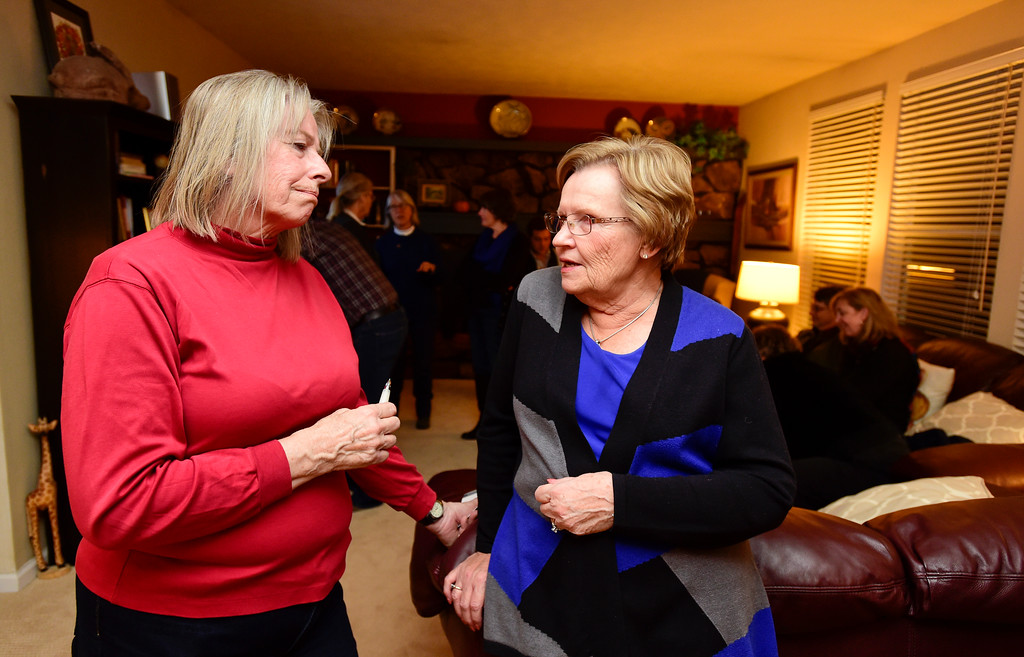 . Council at-Large candidate Polly Christensen, left, talks with Jan Kukic, right, during a watch party for election results at the home of Tim Waters in Longmont, Colorado on Nov. 7, 2017. (Photo by Matthew Jonas/Times-Call)