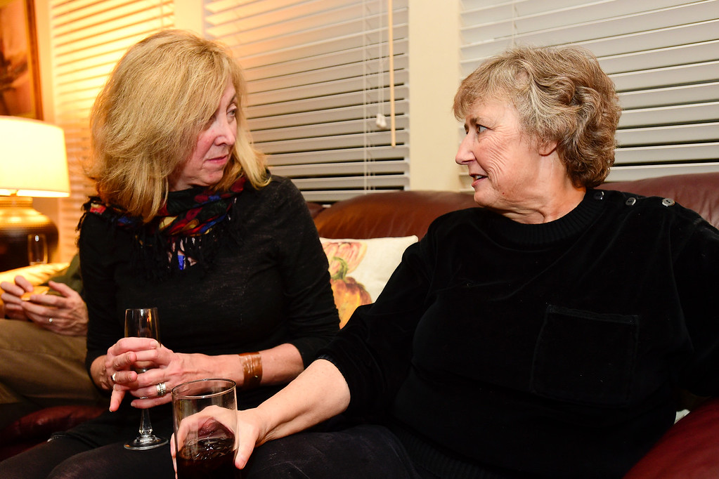 . Ward 2 Council candidate Marcia Martin, right, talks with Kim Monteleone, left, during a watch party for election results at the home of Tim Waters in Longmont, Colorado on Nov. 7, 2017. (Photo by Matthew Jonas/Times-Call)