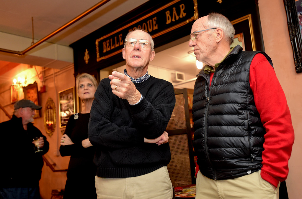 . Roger Lange, candidate for Longmont Mayor, center, watches election results with supporter Bob Roggow, right, at Cheese Importers in Longmont, Colorado on Nov. 7, 2017. (Photo by Matthew Jonas/Times-Call)