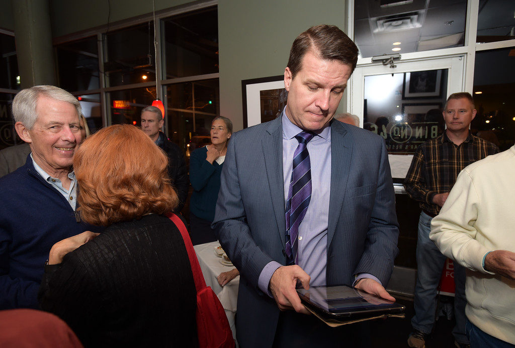 . Longmont mayoral candidate Brian Bagley checks early election results at Bin 46 Wine Bar & Restaurant Tuesday night. Lewis Geyer/Staff Photographer Nov. 07, 2017