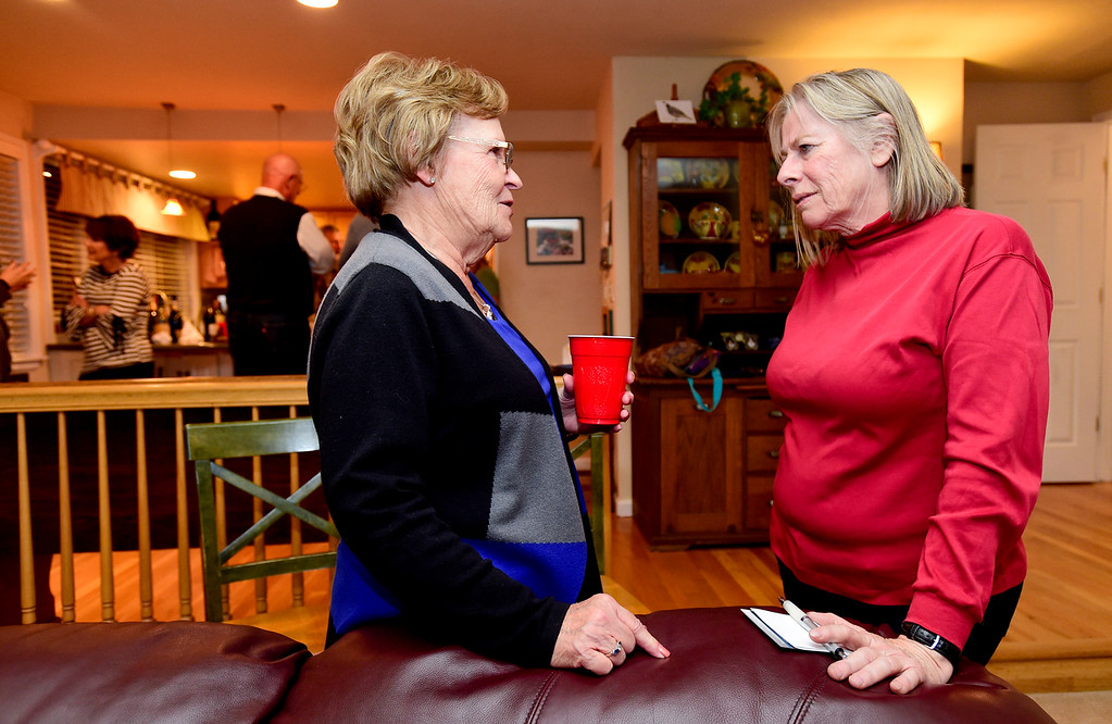 . Council at-Large candidate Polly Christensen, right, talks with Jan Kukic, left, during a watch party for election results at the home of Tim Waters in Longmont, Colorado on Nov. 7, 2017. (Photo by Matthew Jonas/Times-Call)