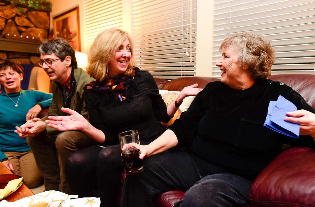 . Ward 2 Council candidate Marcia Martin, right, shares a laugh with Kim Monteleone, left, during a watch party for election results at the home of Tim Waters in Longmont, Colorado on Nov. 7, 2017. (Photo by Matthew Jonas/Times-Call)
