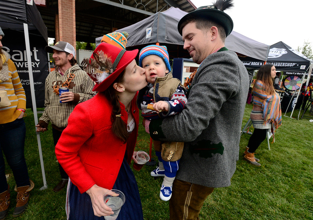 ". LONGMONT, CO OCTOBER 6 2018 Emily Kalkhofer kisses her son Alder, age, 1, as the family including husband and dad Alex attend Longmont Oktoberfest in traditional garb on Saturday. The family\'s background in from Austria. ""This is not a joke for us,\"" said Alex. \""This is serious.\"" (Photo by Paul Aiken/Staff Photographer)"
