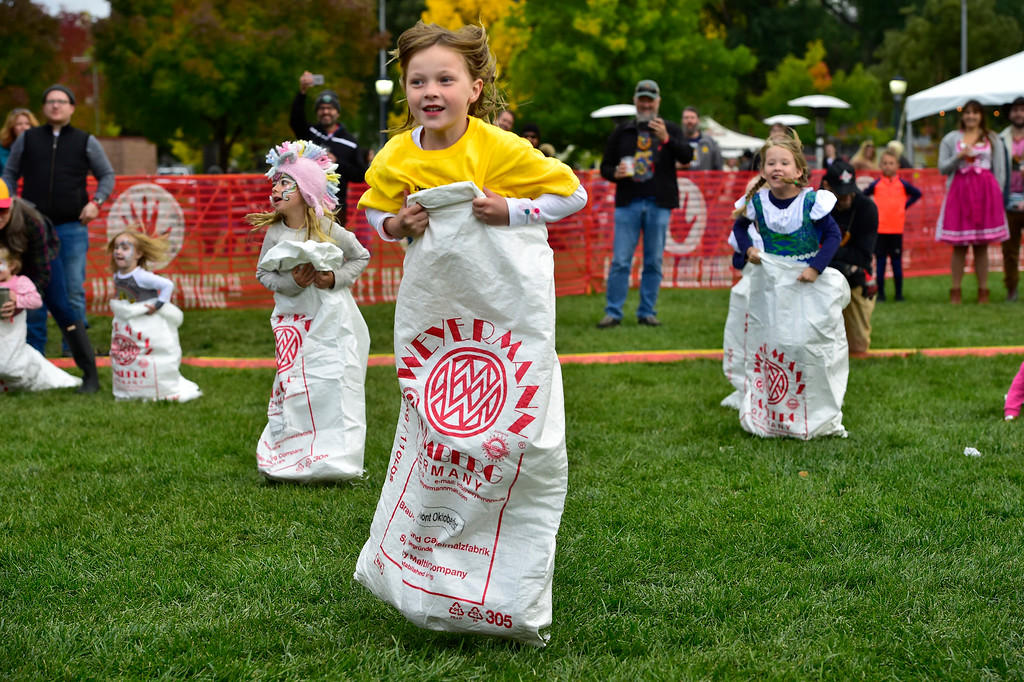 . LONGMONT, CO OCTOBER 6 2018 Addie Loseke heads away from the pack during the sack race at Longmont Oktoberfest on Saturday.  (Photo by Paul Aiken/Staff Photographer)